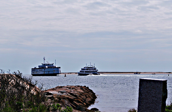 Ferries pass each other in Hyannis Harbor