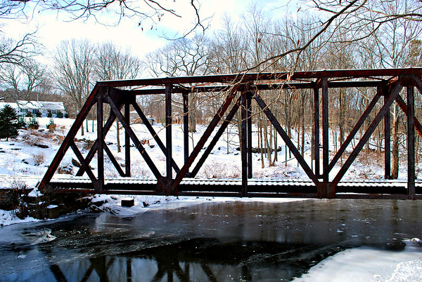 Railroad trestle spanning the frozen Yantic River