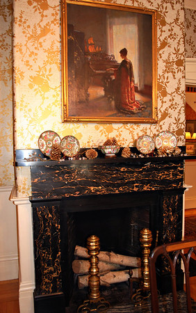 Fireplace constructed of Italian marble that is no longer imported.
