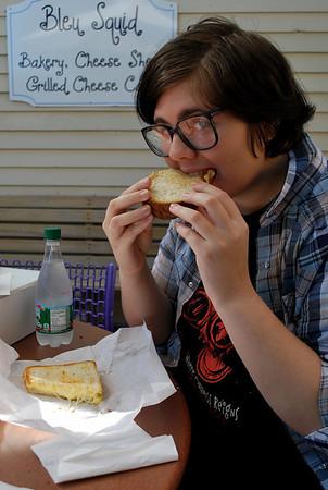 Amanda samples her grilled cheese at Bleu Squid