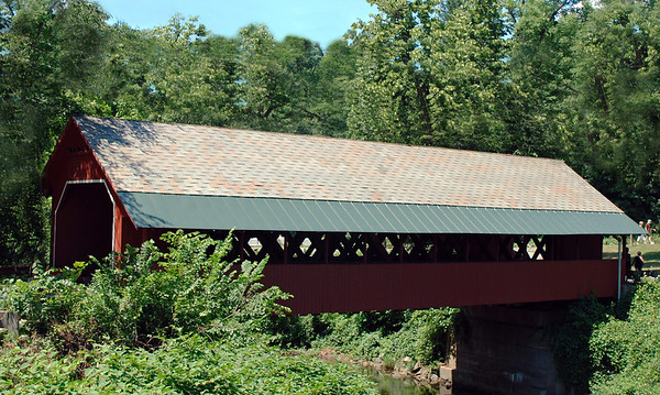 Brattleboro's 1879 Town Lattice design Creamery Bridge had a sidewalk & slate roof added to its design in 1917. Found on Guilford Street, it spans the Whetstone Brook..