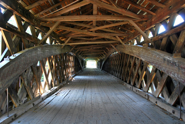 Inside view of the three-span Scott Covered Bridge. The bridge is made up of one Lattice Design truss and two Kingspost trusses put together for a combined total of 276-feet.