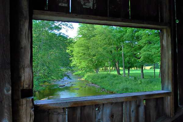 A view of the South Branch of the Saxton River from a window in the MacMillan Covered Bridge.