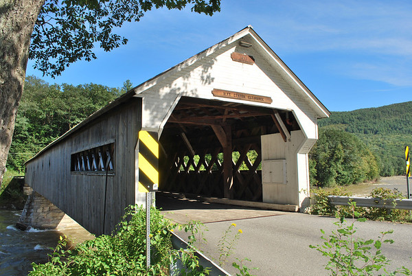 The 1872 Dummerston Covered Bridge spans the West River in West Dummerston, Vermont.