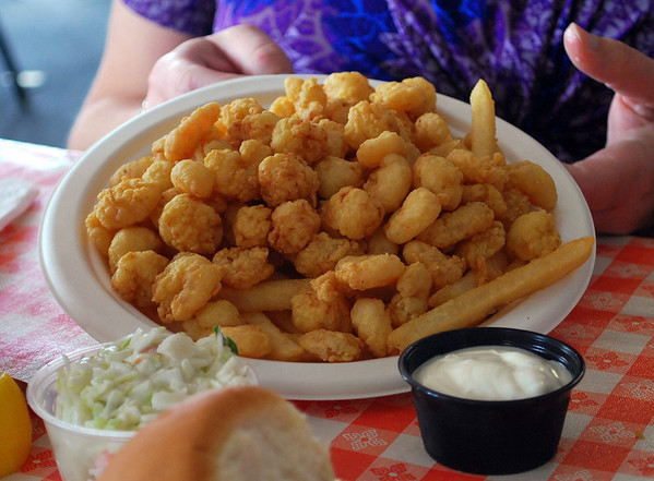 Bay scallops and baby shrimp with french fries.