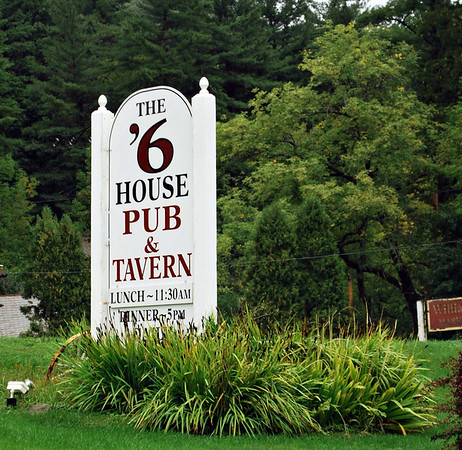 Sign for The '6 House Pub & Tavern at the 1896 House