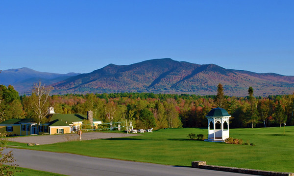 The gazebo and clubhouse with the White Mountains in the background.