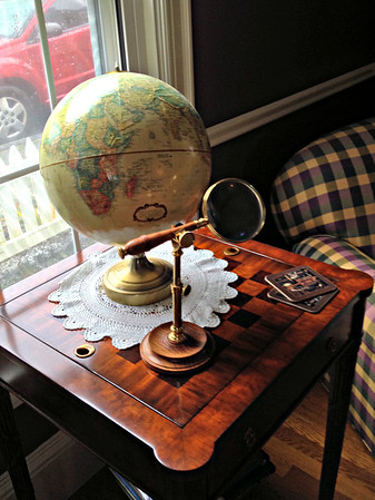 Globe and Magnifying Glass in Library