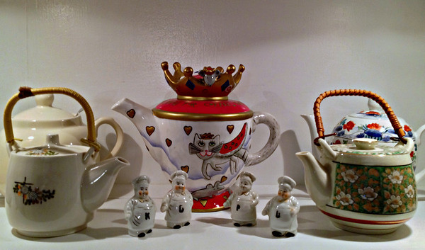 Teapots and Salt and Pepper Shakers in the China Cabinet