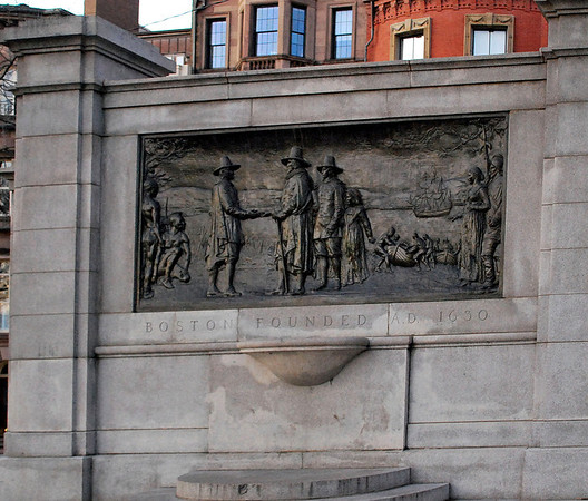 A plaque depicting the founding of Boston in 1630 located in Boston Common.