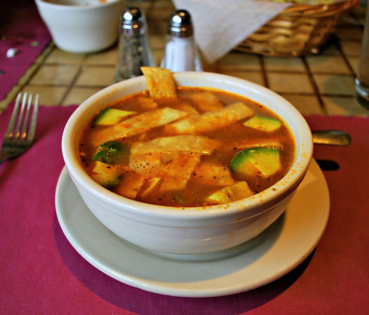 Jalapeno's Tortilla Soup:  Julienne-cut tortillas in a light chicken broth with shredded cheese and avocado. - Yummy!