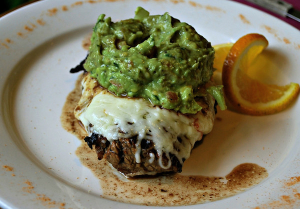 Jalapeno's Steak Gaonera: Charcoal-grilled steak, pan baked with Chihuahua and Monterrey Jack Cheese, topped with chilled guacamole.
