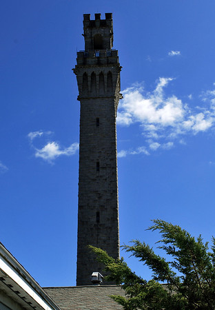 The Pilgrim Monument towers over the roof of the Provincetown Museum