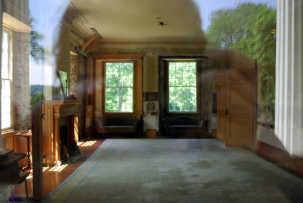 A shot through the window into the main parlor area of the mansion.