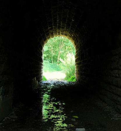 A local legend recounts that the Screaming Tunnel is haunted by the ghost of a young girl, who after escaping a nearby burning farm building with her clothing ablaze, died within its walls.