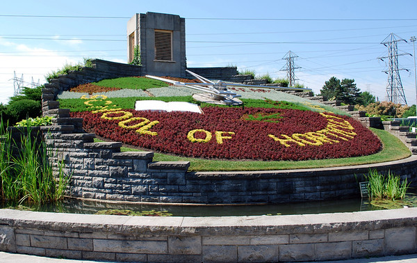 The Floral Clock at Queenston was built by Ontario Hydro in 1950; the planted face is maintained by Niagara Parks horticulture staff while the mechanism is kept in working order by Ontario Hydro. The floral design is changed twice each year with up to 16,000 carpet bedding plants.