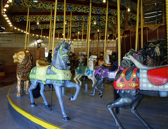 This antique carousel is one of the largest and best remaining examples of a Looff menagerie carousel that is four rows deep with  69 carousel animals including jumpers, standers and a gigantic lion, goats (prancers), giraffes, and camels.
