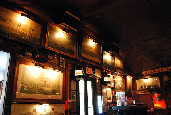 Ship pictures on the walls of the Tap Room at the Griswold Inn