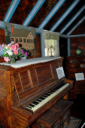 A piano covered with paper rolls
