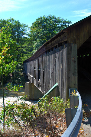 A side view of the Scott Covered Bridge over the West River near Townshend, Vermont.