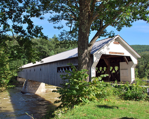 The West Dummerston Bridge was built by Caleb B. Lamson in 1872 and at 280-feet is the longest covered bridge in Vermont.  The bridge, which spans the West River off of Route 30, is of a Town Lattice Design and was completely rebuilt in 1998.