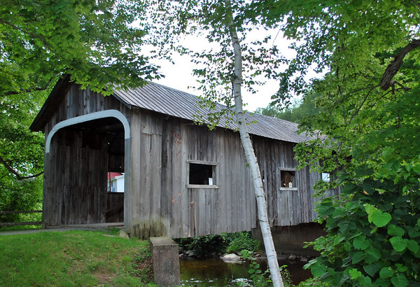 Not a true covered bridge in the classic sense of the term (i.e., intended to carry traffic, covered to protect structural members); the MacMillan Covered Bridge was constructed in 1967 by the non-profit organization which refurbished much of Grafton village.